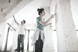 A young couple renovating their living room.