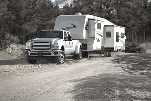 Truck Towing a 5th Wheel Travel Trailer