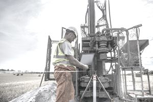person in worker uniform working on oil rig