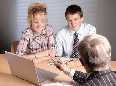Young couple discuss college planning with an advisor