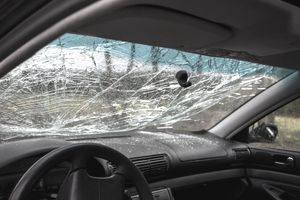 Inside of a car with a broken windshield