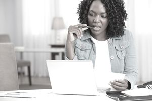African American woman paying bills