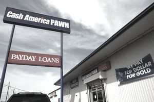 Exterior of a Cash America pawn and payday loan shop.