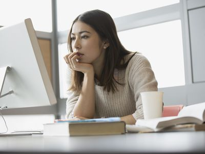 College student looking at 529 Plan information on a computer