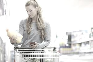 Young woman shopping in a supermarket.