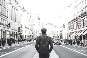 Tourist with backpack walking on Regent Street in London, UK