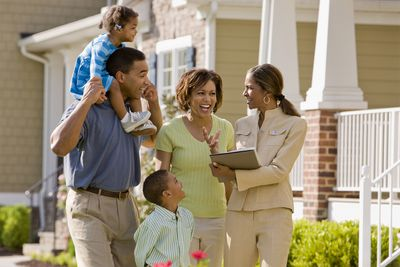 Realtor Showing Home to Family