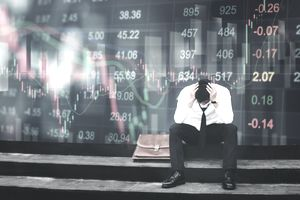 Depressed trader lamenting over a bad investment
