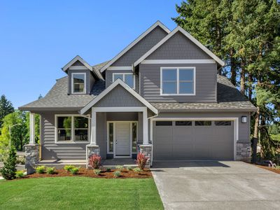 Small gray house with white trim on a green lawn.