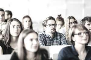 a classroom full of college students listening to a lecture