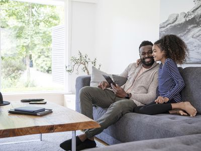 A father and daughter enjoy their new home