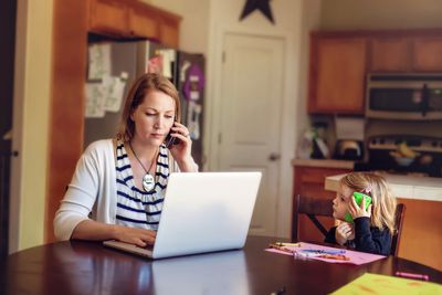 Woman on the phone negotiating with debt collectors