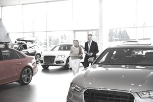 Woman talking to salesperson in a Car Dealership