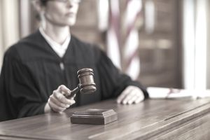 Judge in courtroom with gavel