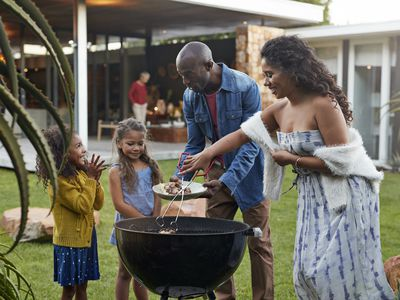 Family in backyard of a high-value home