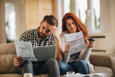 people reviewing medical bills and looking into medical loans