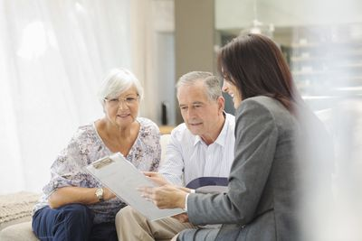 Retirement planner going over financial goals with an older couple