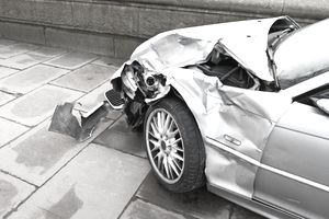 Side view of collision damage on a car.