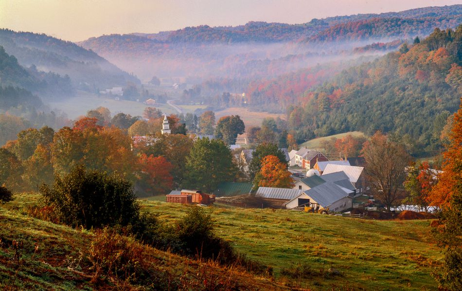 The mountains of East Topsham, Vermont with a farm property in a valley
