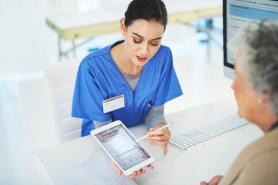 Nurse reviewing information with patient