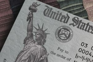 Partial view on a US Treasury payment check - stock photo