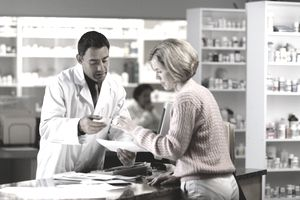 Pharmacist discussing a prescription