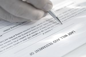 a man signing last will documents
