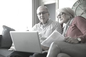 Retired couple looking at computer