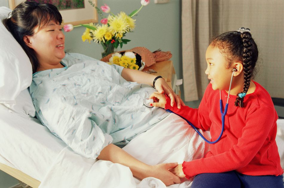 Pregnant lady in hospital with child