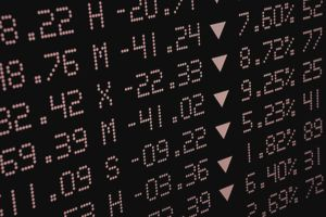 Stock market index board with all arrows pointing down