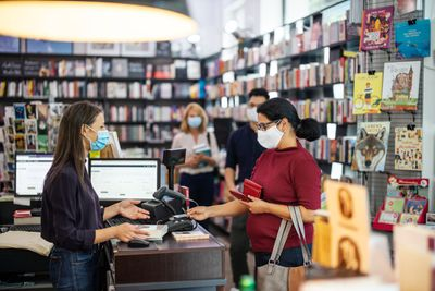 People buying books in a local bookstores