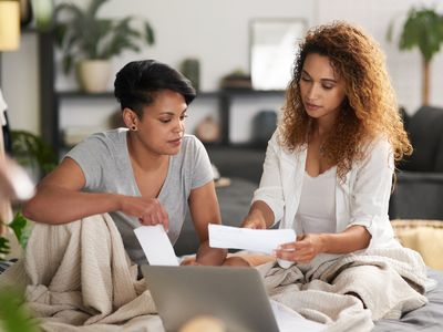 A couple looks over financial paperwork