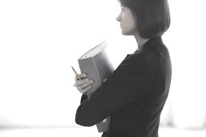 Woman holding a binder of taxes