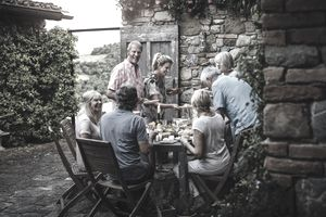 A dinner party of retirees discussing their investment portfolios