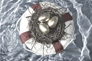 Golden eggs in a nest floating in a lifesaver, representing protecting your savings and investments.