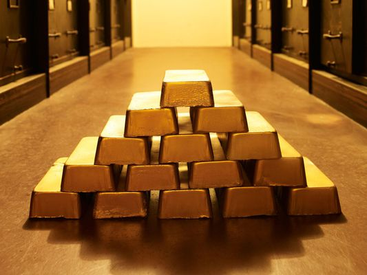 Gold bars on the floor of a vault