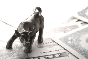 Charging Bull On Top Of Stock Certificates