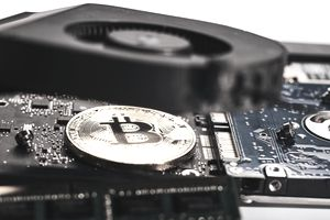 A gold bitcoin on computer chips.
