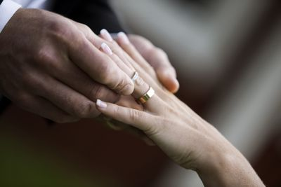 Bridegroom and bride putting on rings