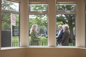 Senior couple visit new home with an estate agent