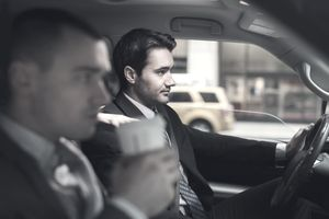Two businessmen in car