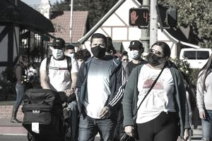 SOLVANG, CA - NOVEMBER 28: Groups of people, most wearing facemasks, take over the sidewalks in downtown on November 28, 2020, in Solvang, California. Despite a rapidly rising surge of cases and deaths in California, and lack of a Julefest parade and other holiday festivities, thousands of tourists, primarily from Southern California and Los Angeles continue to flood into this Danish-themed Central Coast community each weekend.