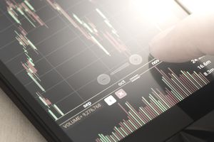 close up a man checking stock market on tablet, smartphone