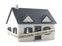 foreclosure house wrapped in foreclousre tape