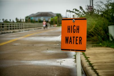 Disaster area with high water sign