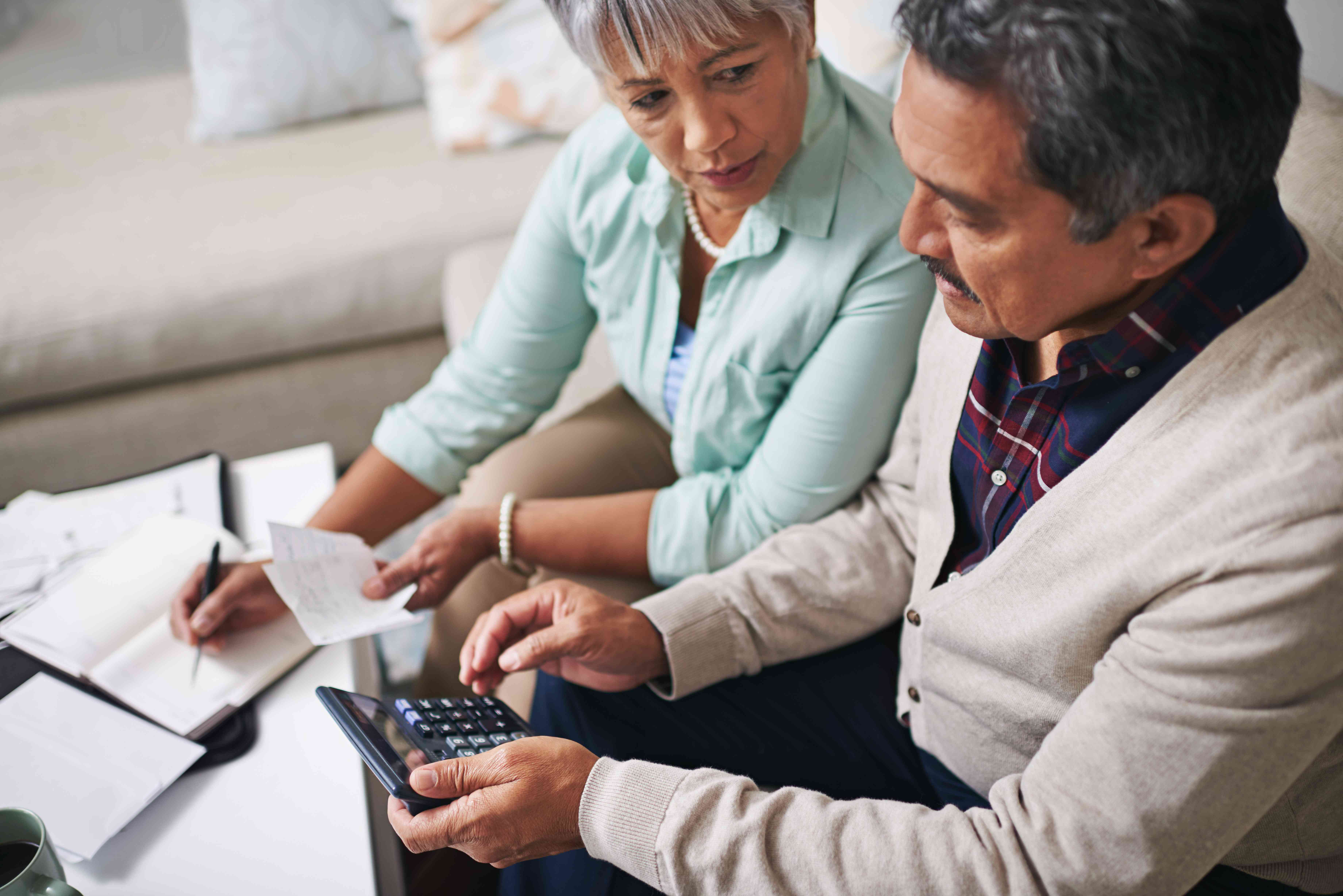Couple reviewing receipts to track expenses