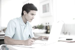 Teenager review financial aid options for college.